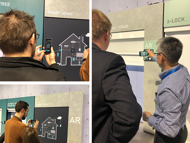 Image of People interacting with AR markers at trade fair